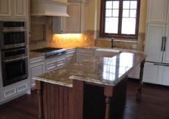 Kitchen with marble panel and center island