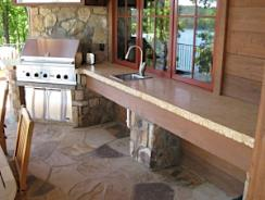 Lovely outdoor patio with a granite counter top and sink.